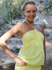 With her charming, youthful allure, tanned complexion, beautiful firm breasts with puffy nipples, Mango\'s natural beauty stands out on a rocky location. - Erotic and nude pussy pics at GirlSoftcore.com