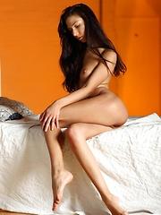 Refined and elegant brunette with ultra flexible, slender body.