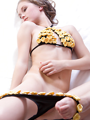 Caesaria raises the room temperature with a slow and sensual striptease of her skimpy black bikini with yellow miniature roses - Erotic and nude pussy pics at GirlSoftcore.com