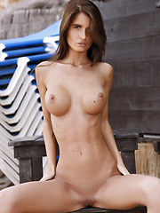 Nessa is a top ten model for her strong features, like long legs and coffee tan and bigger firm breasts. - Erotic and nude pussy pics at GirlSoftcore.com