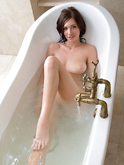 Simone cools down her sizzling hot, voluptuous body in the bathtub. - Erotic and nude pussy pics at GirlSoftcore.com