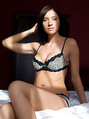 Straight, silky brown hair, enchanting brown eyes, willowy physique, and smooth, supple body garbed in sexy black lingerie makes Simone a enticing company in bed.