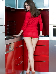Wearing a bright red dress, Quinn is a sumptuous feast for the senses as she showcases her smooth, fair-skinned body and fresh assets on the kitchen. - Erotic and nude pussy pics at GirlSoftcore.com