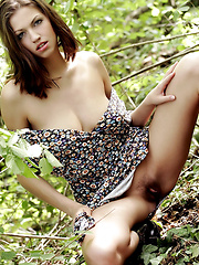 Tall model with short brunette hair goes out to nature with boots to kick ass and take names. - Erotic and nude pussy pics at GirlSoftcore.com