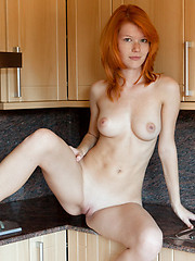 European redhead beauty shows her cherry on the kitchen - Erotic and nude pussy pics at GirlSoftcore.com