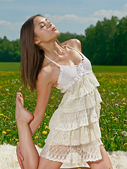 With her confident and elegant poses, Nastya youthful beauty stands out amidst a vast green field covered with tiny delicate flowers. - Erotic and nude pussy pics at GirlSoftcore.com