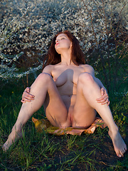 Burning hot redhead walks slowly through the flowers and lets her own aroma of sweet musky sex fill your nose. - Erotic and nude pussy pics at GirlSoftcore.com