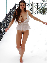 Snow girl with dark hair and large breasts plays in the white stuff while her furry bush gets cold. - Erotic and nude pussy pics at GirlSoftcore.com