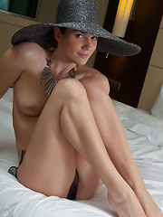 Wearing a broad brimmed hat, a chunky piece of necklace, and a sheer black panty - Erotic and nude pussy pics at GirlSoftcore.com
