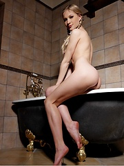 Candice B poses in a bathroom - Erotic and nude pussy pics at GirlSoftcore.com