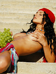 Jenya plays gypsy in the village while revealing her firm breasts and tanned body. - Erotic and nude pussy pics at GirlSoftcore.com