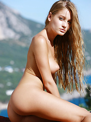 Outside in the fresh air is Veronika and her wonder breasts, pert little ass and sly smile.