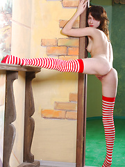 Refreshing as a candy cane is this brunette with long colorful socks.