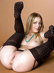 Blonde babe Sharon shows her cute body - Erotic and nude pussy pics at GirlSoftcore.com