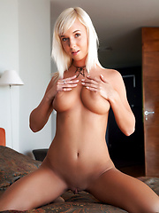 Gorgeous platinum blonde with perfect tan all over even her hairless pussy. - Erotic and nude pussy pics at GirlSoftcore.com