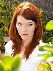Redhead Mia Solis posing outside