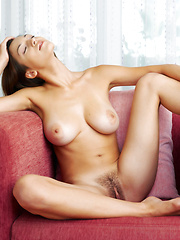 Fun brunette with a big trimmed bush and crazy hair is laying on her back spread out like butter. - Erotic and nude pussy pics at GirlSoftcore.com