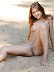 Teen posing on the sand