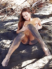 Latin girl outside in the mud, showing all her sexy petite body to the whole internet. - Erotic and nude pussy pics at GirlSoftcore.com