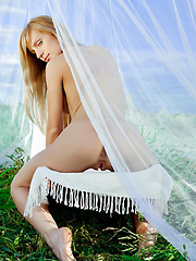 Blonde model lays out on the hammock and spreads her legs to show her amazing sex box. - Erotic and nude pussy pics at GirlSoftcore.com