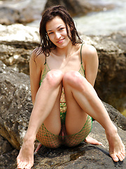 Alone girl Sofi posing at the beach - Erotic and nude pussy pics at GirlSoftcore.com