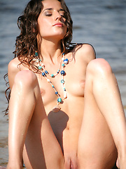 Irina is radiant while laying on the beach nude and exposed with a clean shaven chastity spot. - Erotic and nude pussy pics at GirlSoftcore.com