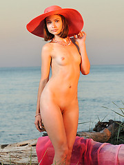 Beautiful shapely charmer in a hat with a wide brim showing tits and pussy on the seaside. - Erotic and nude pussy pics at GirlSoftcore.com