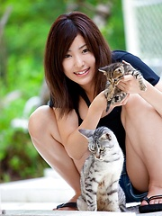 Large breasted Maki Kokoro posing outside - Erotic and nude pussy pics at GirlSoftcore.com