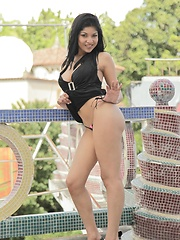 Natalia Spice gets nude on a rooftop and spreads those long legs of hers - Erotic and nude pussy pics at GirlSoftcore.com