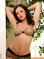 Busty babe Aria Giovanni flashes her boobs
