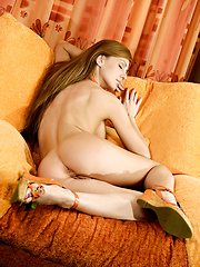 Girl posing on the couch at home - Erotic and nude pussy pics at GirlSoftcore.com
