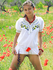 Sima enjoys a relaxing weekend,   sunbathing among the flowery fields for   her debut series. - Erotic and nude pussy pics at GirlSoftcore.com