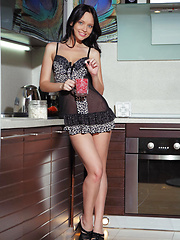 Stripping her sexy see-through nightwear, Marica looks enticingly delectable as she poses erotically on the kitchen. - Erotic and nude pussy pics at GirlSoftcore.com