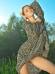 Bridgit playfully strips her beautiful dress and poses sensually all over the sand. - Erotic and nude pussy pics at GirlSoftcore.com