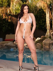 Gorgeous busty babe, Aria Giovanni, looks amazing in her tiny swimsuit.  Her natural big boobs are squeezed in and the bottom gives her pussy an awesome camel toe.