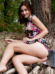 Beautiful teen taking off her clothes and demonstrating shaved pussy and tight ass outdoor. - Erotic and nude pussy pics at GirlSoftcore.com