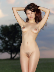 Cute long haired bombshell undressing and demonstrating naughty quim outdoor in the field. - Erotic and nude pussy pics at GirlSoftcore.com