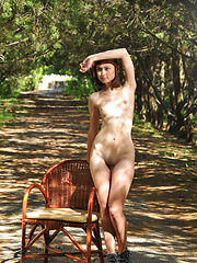 Delicious dark haired sweetie undressing and posing naked outdoor on the chair in the park. - Erotic and nude pussy pics at GirlSoftcore.com