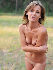 Lovely slender babe likes to pose naked on the sun in wild environment. Wilderness out as well inside is her best asset. - Erotic and nude pussy pics at GirlSoftcore.com