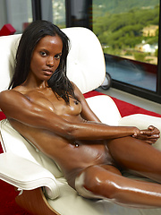 Black girl on the couch - Erotic and nude pussy pics at GirlSoftcore.com