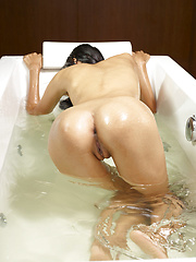 Naked adian model relaxing in the bath - Erotic and nude pussy pics at GirlSoftcore.com