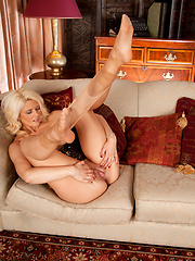 Gorgeous Anilos babe showing off her plump pussy on the couch - Erotic and nude pussy pics at GirlSoftcore.com