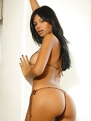 Karla Spice teases you in her tiny tan bikini - Erotic and nude pussy pics at GirlSoftcore.com