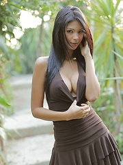 Karla Spice models her little brown dress but soon takes it off - Erotic and nude pussy pics at GirlSoftcore.com