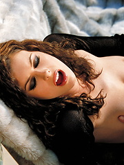 Ginger Jolie - Laying in furs in black top and skirt - Erotic and nude pussy pics at GirlSoftcore.com