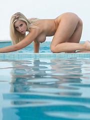 Teen playing around the pool - Erotic and nude pussy pics at GirlSoftcore.com