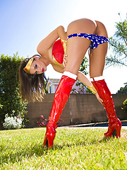 Brunette Tori Black looks hot as Wonder Woman - Erotic and nude pussy pics at GirlSoftcore.com