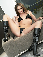 Tori Black strips a leather bikini before frigging herself - Erotic and nude pussy pics at GirlSoftcore.com