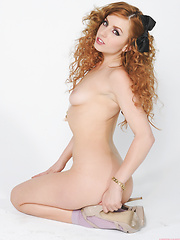 Lexi Belle strips off a tiny skirt and revealing top