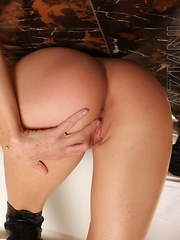 Nicole Sheridan in her tight sexy black dress and big black boots performs quite a striptease. - Erotic and nude pussy pics at GirlSoftcore.com
